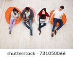 group of young friends using... | Shutterstock . vector #731050066
