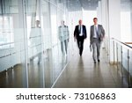 business people walking in the