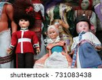 group of dolls displayed on a... | Shutterstock . vector #731083438