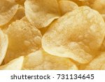 close up potato chips on wood... | Shutterstock . vector #731134645
