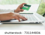 young woman holding credit card ... | Shutterstock . vector #731144836