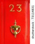 Golden Sign On Red Wooden Door...