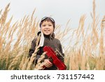 the boy is standing in the tall ... | Shutterstock . vector #731157442