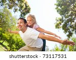 father playing with his... | Shutterstock . vector #73117531