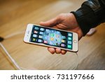 Small photo of Berlin, October 2, 2017: presentation of the iPhone 8 and iPhone 8 plus and sales of new Apple products in the official Apple store in Berlin. The buyer holds a new iPhone 8 plus.