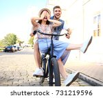 happy funny young couple riding ... | Shutterstock . vector #731219596