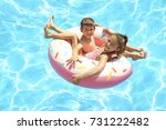 cute children on inflatable... | Shutterstock . vector #731222482