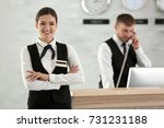 Stock photo female hotel receptionist at workplace 731231188