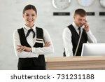 female hotel receptionist at... | Shutterstock . vector #731231188