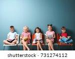 cute little children reading... | Shutterstock . vector #731274112