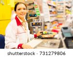 Small photo of Sales Clerk In The Supermarket