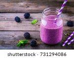 blackberry smoothie in a mason... | Shutterstock . vector #731294086
