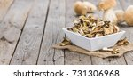 homemade dried porcinis on an... | Shutterstock . vector #731306968