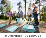 coworkers making pyramid with... | Shutterstock . vector #731309716