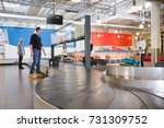 travelers waiting for luggage... | Shutterstock . vector #731309752