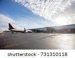 airplane on wet runway against...   Shutterstock . vector #731310118