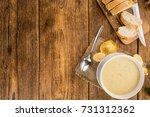 portion of fresh chanterelle... | Shutterstock . vector #731312362