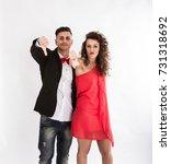elegant couple thumbing down... | Shutterstock . vector #731318692