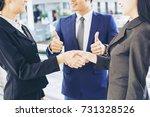 team business partners giving... | Shutterstock . vector #731328526