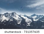 paragliding above the alps | Shutterstock . vector #731357635