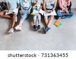 overhead view of student's legs ... | Shutterstock . vector #731363455
