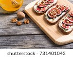 toast with figs   walnuts and ... | Shutterstock . vector #731401042