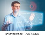 Young Men pushing a button on a touch screen. Two Virtual Keyboard. - stock photo