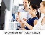 business people in modern office | Shutterstock . vector #731443525