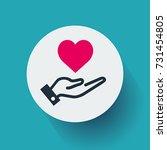 red heart on hand   Shutterstock .eps vector #731454805