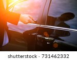 Small photo of hand of businessman presses on the remote control car alarm systems.