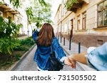 look from behind at young woman ... | Shutterstock . vector #731505502