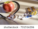 treat colds  apples or tablets | Shutterstock . vector #731516206