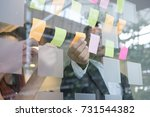 business team look at the... | Shutterstock . vector #731544382