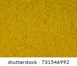 Small photo of Background macro texture of the banal yellow synthetic sponge for washing dishes