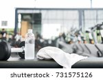 black dumbbell  bottle of...   Shutterstock . vector #731575126