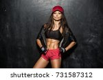 attractive fitness woman ... | Shutterstock . vector #731587312