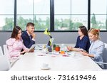 a group of office workers sit... | Shutterstock . vector #731619496