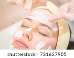 masking on the face in the salon | Shutterstock . vector #731627905