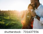 couple walking outdoors with a...