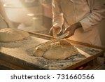 in an artisan bakery  a baker... | Shutterstock . vector #731660566