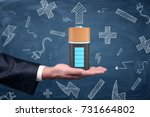 a male businessman's hand holds ... | Shutterstock . vector #731664802