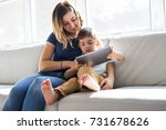 a little boy with digital... | Shutterstock . vector #731678626