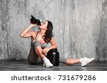 young woman with protein shake... | Shutterstock . vector #731679286