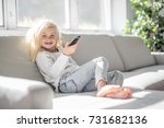 a 4 years old child watching tv ... | Shutterstock . vector #731682136