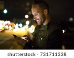 a handsome man using smart... | Shutterstock . vector #731711338