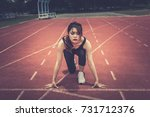 Small photo of Beautiful asian woman prepare running on the track,Go to winner,Thailand people,Intend to victory.