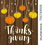orange and yellow pumpkins on a ... | Shutterstock . vector #731733535
