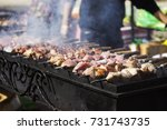 meat on skewers and fried on a... | Shutterstock . vector #731743735