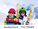 kids skiing in mountains.... | Shutterstock . vector #731778385