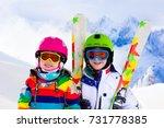 kids skiing in mountains....   Shutterstock . vector #731778385